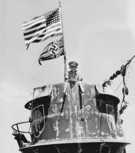 Daniel Gallery, Commanding Officer of the Guadalcanal on the Conning Tower of the captured U-505. Photo by USN (June 1944). PD-US Government. Wikimedia Commons.
