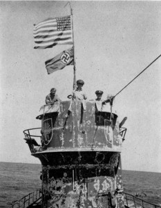 U.S. Naval Officers on the submarine's conning tower. Photo by USN (June 1944). PD-US Government. Wikimedia Commons.