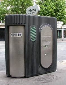 A public toilet, Paris, France. This is a modern Sanisette. Photo by Riggwelter (2006). PD-CCA Share Alike 4.0 International and attribution: user: (WT-shared) Riggwelter at wts wikivoyage. Wikimedia Commons.