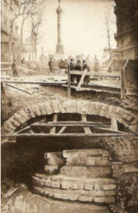 Foundation—Liberty Tower—of the Bastille during excavation of Méetro line. Photo by unknown (1899). Wikimedia Commons.